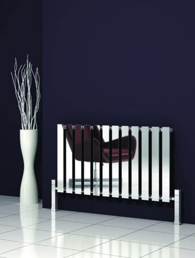 compact radiators for home' stainless steel horizontal radiator installed next to a white vase