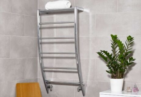 Portofino Chrome stylish heated Towel Rail in a bathroom