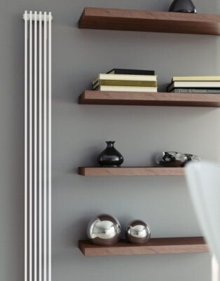 Flat panel radiator benefits; stainless steel flat radiator placed next to an open shelf