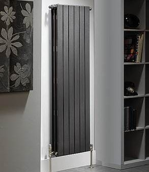 Flat panel radiator benefits; blackish grey designer radiator placed on an accent wall