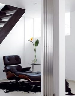 Flat panel radiator benefits; stainless steel flat radiator placed on a narrow wall