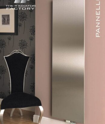 Brownish flat panel radiator installed on a pink wall