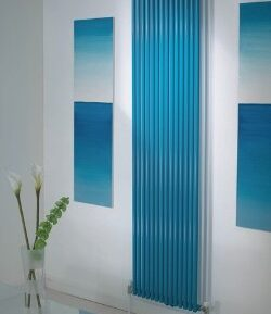 TRC 25 vertical radiator in shades of sky blue adds a pop of colour in a modern home done in neutral shades