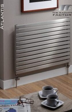Steel horizontal radiator installed below a photo frame