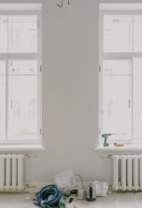 Painting Your Radiator; materials kept between two radiators fixed below windows placed next to each other