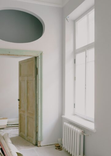 Painting Your Radiator; a messy passage with a compact column radiator below the window