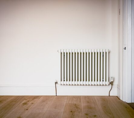 Painting Your Radiator; a white column radiator fixed on a bare white wall