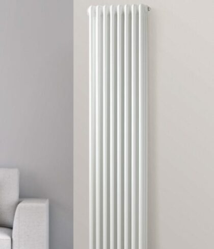 all white column radiator installed on an off white wall