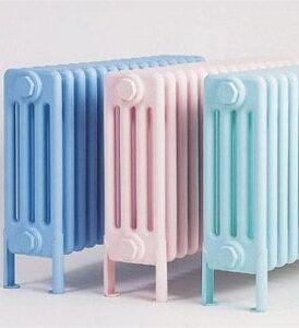 compact radiators for home; blue, pink and sky blue coloured electric radiators arranged next to each other